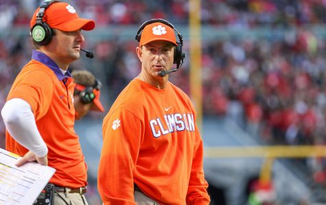 Coaching his team on the sideline, Clemson Tigers coach Dabo Swinney plans to win another game to protect his undefeated record. Swinney has coached at Clemson for many years and plans to continue after he ended his tenth season with his second National Championship title. With the leadership of freshman quarterback Trevor Lawrence and several of the seniors, the Tigers proved they are now the team to beat.