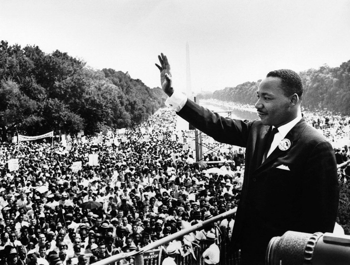 "Waving to the hundreds of thousands of people who marched with him, Martin Luther King, Jr. finishes up his famous ""I Have A Dream"" speech in Washington, D.C. King was a profound leader during the Civil Rights Era, demanding equal rights to African Americans as those given to whites."