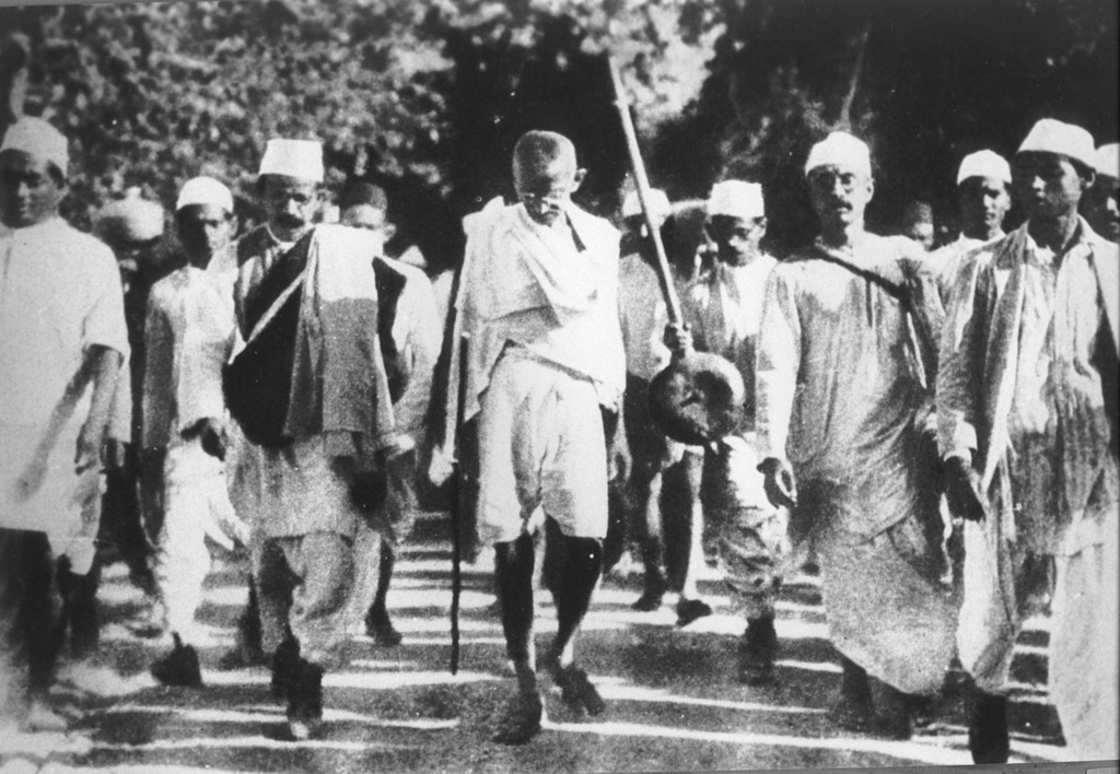 Gandhi leads many people who looked up to him as an influencer in a peaceful protest. One form of a passive resistance protest that he helped lead was the Salt March which resulted in the arrest of nearly 60,000 people, including Gandhi himself.