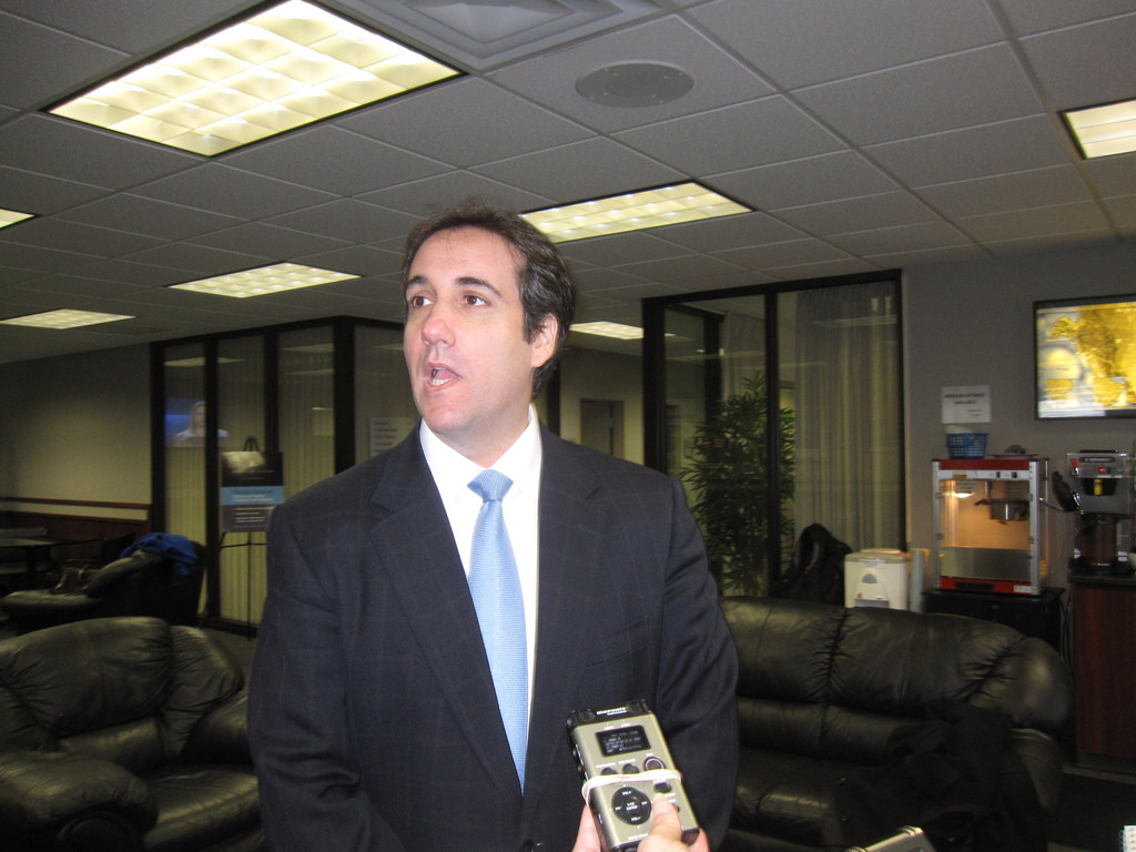 Taken in 2011, this image captures Michael Cohen speaking to a group of reporters, and most likely divulging important political information. The picture shows Cohen in a time that he was serving President Trump, and was admittedly lying for him, as is now being revealed in front of Congress.