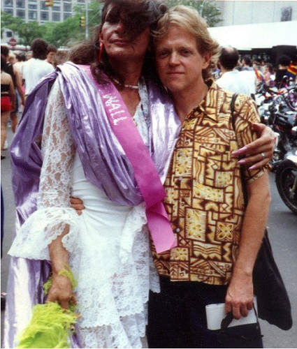 Posing with Jim Fouratt (right), Sylvia Rivera celebrates at a Pride March in 1977. Although she was typically not welcome to these events, Rivera would attend anyways to push barriers in the community.