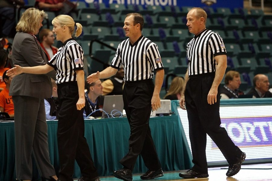 Shaking hands with thankful coaches, these three referees are pictured during a rare moment. More often than not, refs are not thanked for the work they do, and instead, are blamed for a team's loss or for any call that is made.