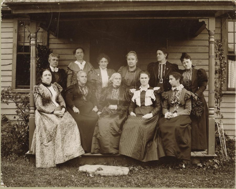 Pictured with fellow Women's Rights activists of her time, Susan B. Anthony is seated in the center. Anthony is known for her relentless campaigning during the Women's Suffrage Movement.