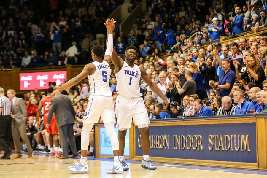 High+fiving%2C+forwards+RJ+Barrett+and+Zion+Williamson+congratulate+each+other+after+beating+Louisville+71-69.+The+Duke+Blue+Devils+have+a+great+chance+to+come+out+as+champions+of+the+NCAA+Tournament.+