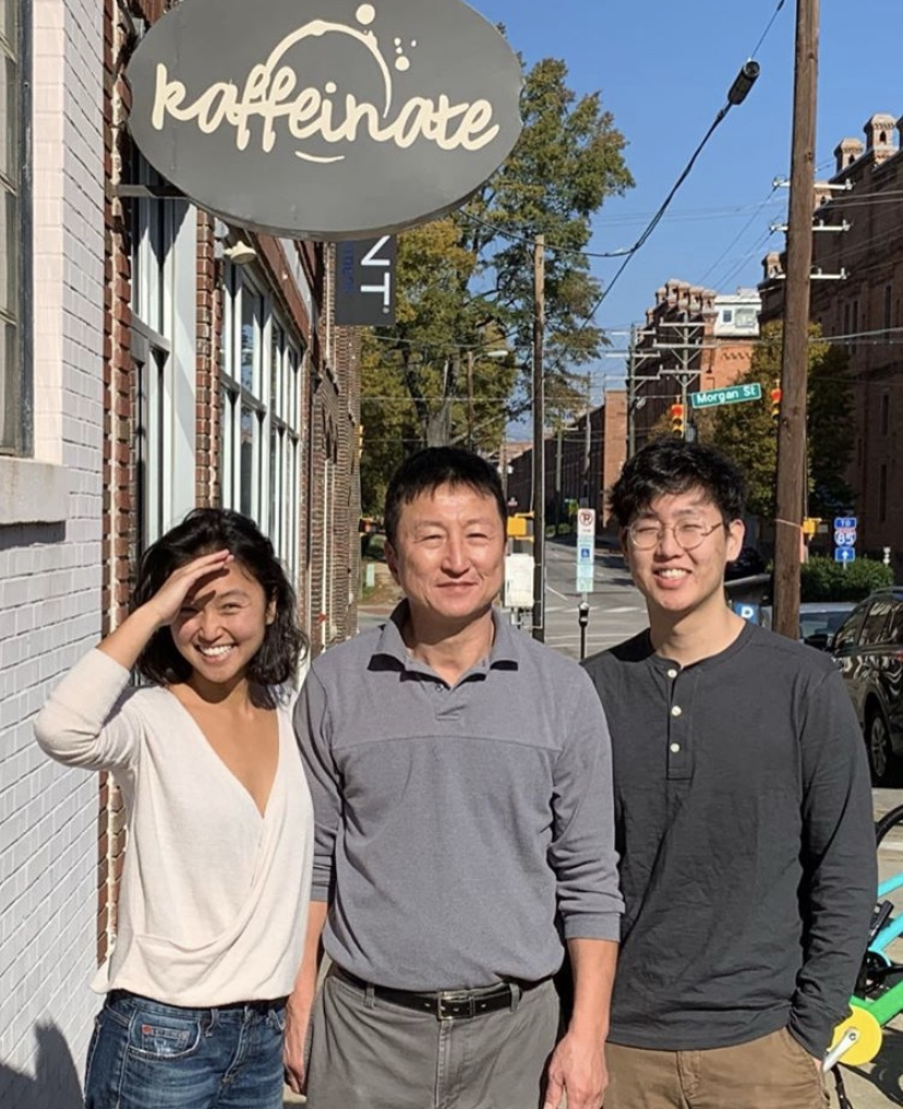 Standing alongside his two children, Kaffeinate owner Kong Lee smiles brightly outside of his store where a tragedy would later occur. Lee passed shortly after a gas leak in Durham led to an explosion on North Duke Street.