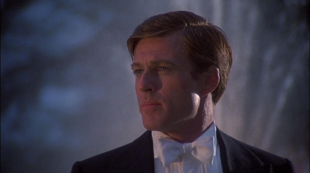 Looking off in the distance while daydreaming about his love obsession, Robert Redford stars as Jay Gatsby in the 1974 film. The Great Gatsby has seen many screen and film adaptations over the years, but many say none could capture Gatsby as well as Fitzgerald's writing.