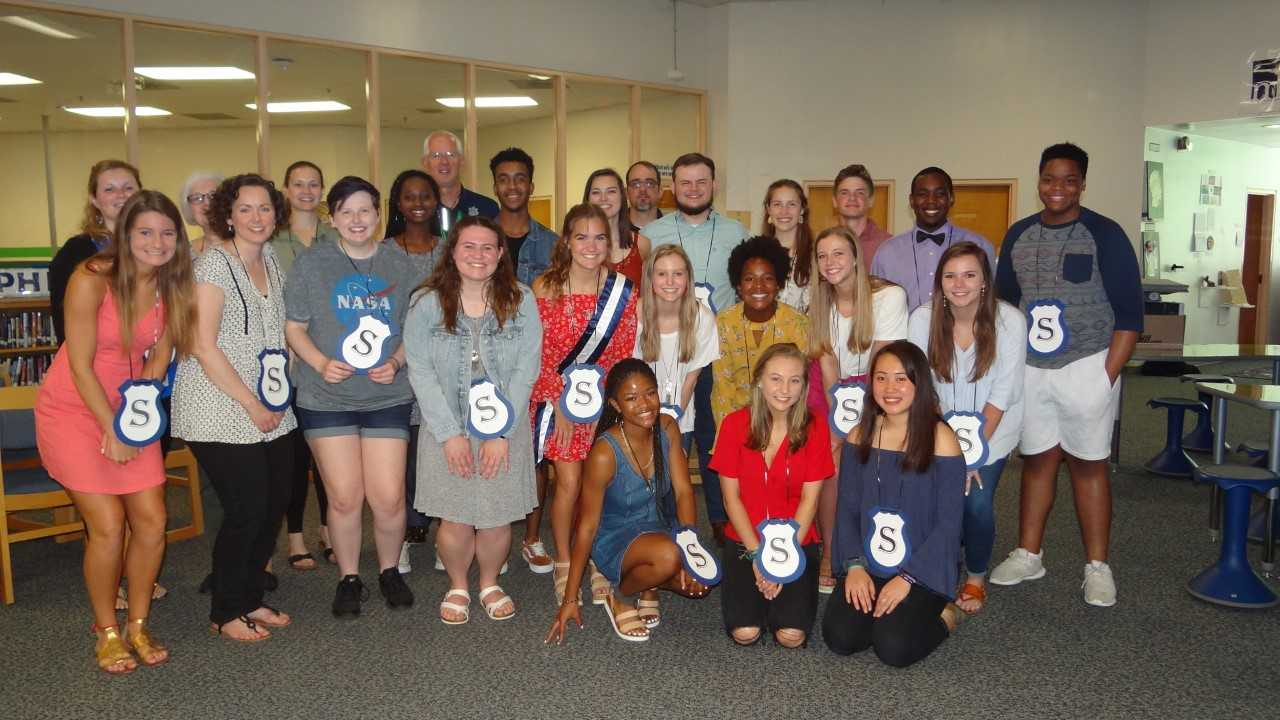 Smiling bright, new members of Millbrook's Service Club celebrate being inducted into this highly selective club. Service Club honors students, faculty, and community members who go above and beyond in the Millbrook community and defines what it means to serve.