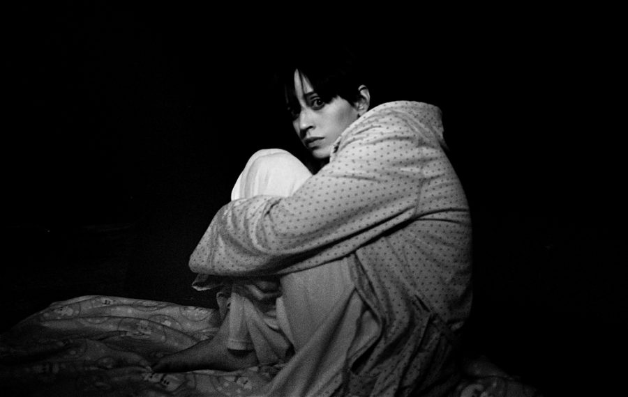 Awakened from her slumber, a women frightened from her nightmare struggles to go back to sleep. Nightmares happen in the REM phase of the sleep cycle and usually occur early in the morning, hours before your normal wake up time.