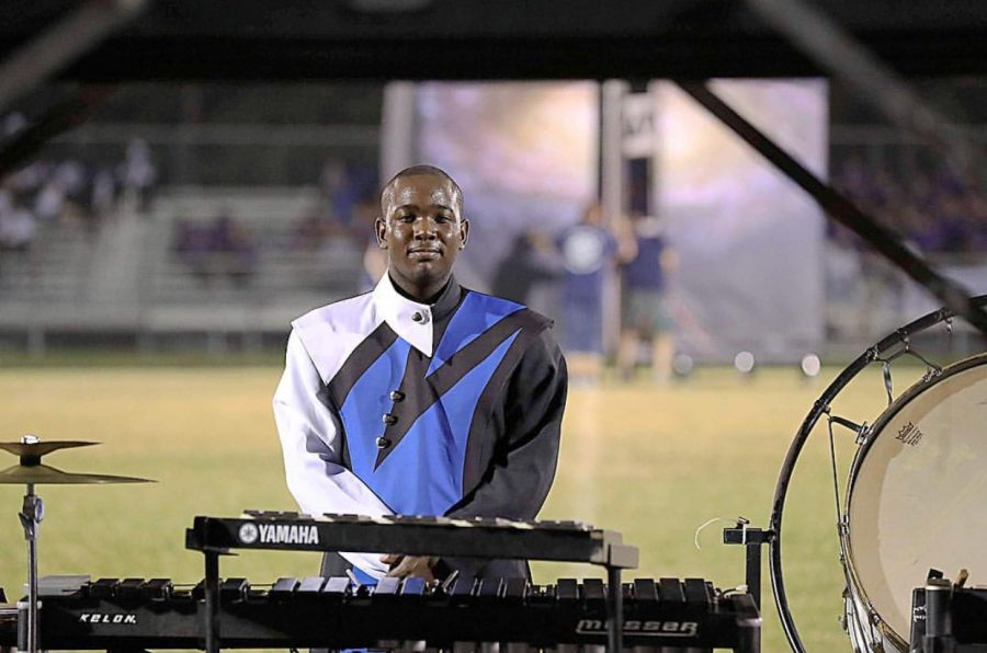 Standing+on+the+sidelines%2C+Britt+drums+with+the+Millbrook+Marching+band.+Watch+out+for+him+next+year+as+he+continues+to+wow+the+crowd%21+