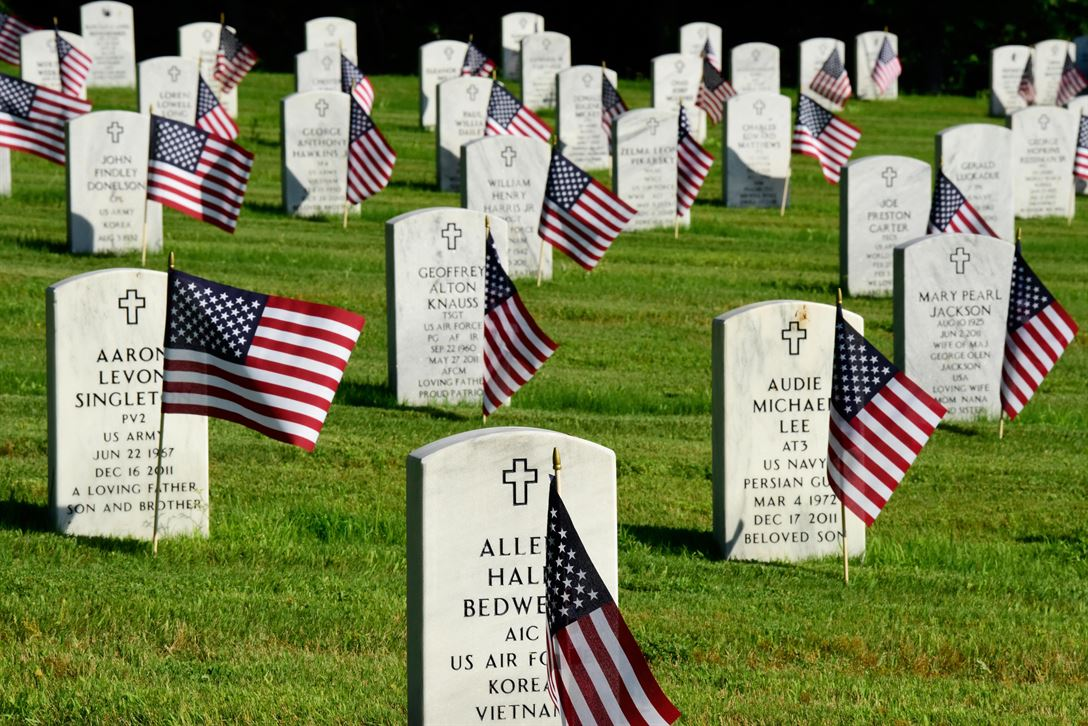 American flags decorate headstones at the Arkansas State Veterans Cemetery in Little Rock after the 2017 Memorial Day flag placement observance. It is customary for current US soldiers to conduct the ceremony.
