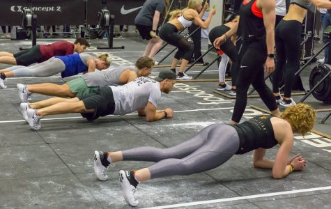 Positioned in planks, these athletes engage in one of the many exercises that can be effectively incorporated into high-intensity interval training, or HIIT, workouts. HIIT requires a short period of difficult exercise followed by an even shorter period of rest in order to help you progress faster towards your fitness goals.