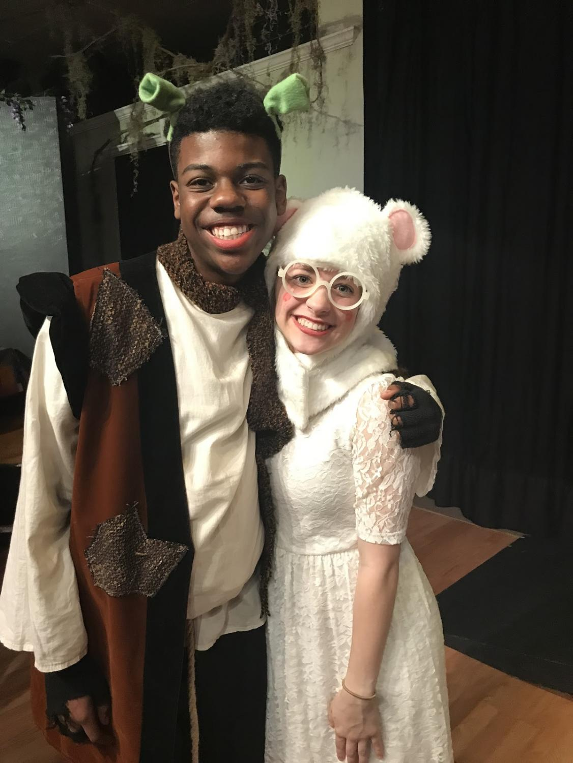 Standing next to his former cast member, Christian smiles after a successful performance of Shrek. Theatre and the arts is something that Christian is very passionate about in and out of school.