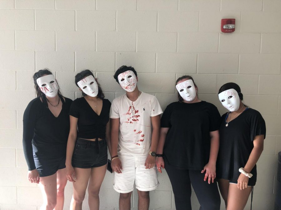 Wearing+avant-garde+masks%2C+this+group+of++juniors+is+ready+to+perform+at+Outdoor+Drama.+Their+scene+was+based+on+the+seven+deadly+sins%2C+and+their+eerie+performance+left+the+audience+shocked.