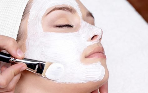 Getting a facial, this person takes time to care for her skin by going to the spa. There are many ways to pamper yourself and improve your skin, including moisturizing, exfoliating, monitoring your diet, using all-natural beauty products, and more.