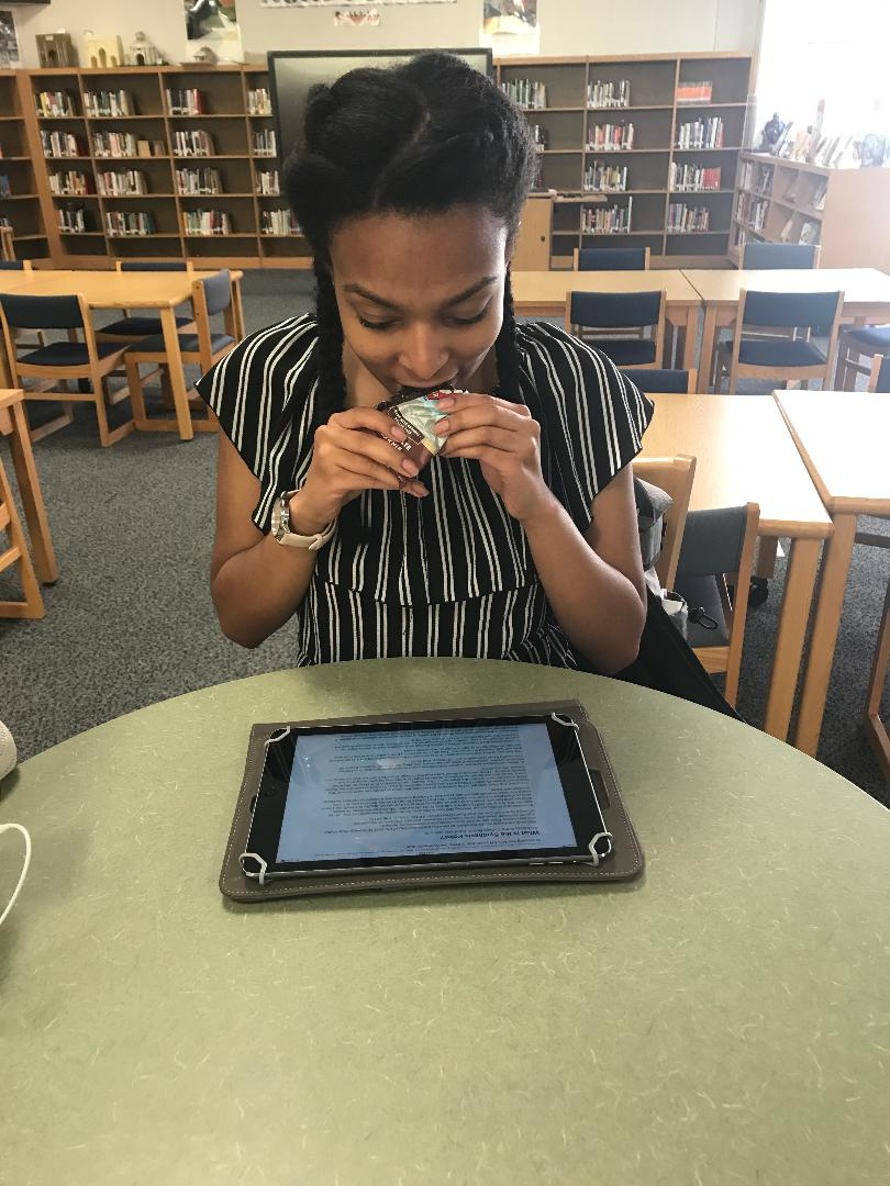 Taking a break from studying, sophomore Sitara Brent takes a bite out of her nutritious Clif Bar. By giving yourself a five minute break and a nutritious snack in between studying, you can increase your energy and maintain your focus.