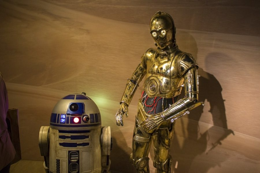 Standing+side+by+side+these+two+droids+known+as+C-3po+and+R2-D2+are+staples+of+the+Star+Wars+franchise.+These+characters+along+with+a+plethora+of+others+from+the+Star+Wars+universe+transcend+the+screen+and+are+household+names.++