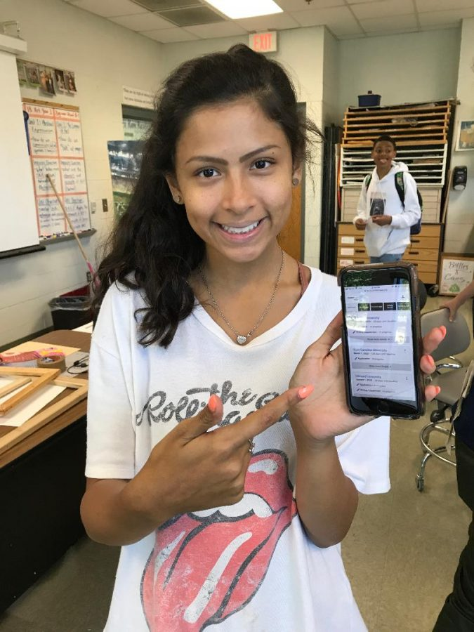 Pointing at her Common Application account, Senior Kaylee Zuniga hides her college stress behind a smile. Although planning for college can be stressful, Kaylee took the steps that were necessary for her success throughout high school so that she can be confident in her application now.