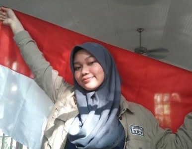 Posing with the official Indonesian flag, junior Farhanah Arifah wants to share her unique culture with all of Millbrook High School. By sharing different cultures, one will be able to connect with and communicate with people from those societies.