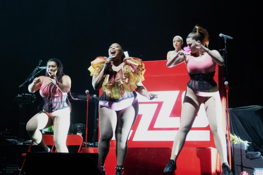 Performing to her large fanbase, breakout sensation Lizzo sings and dances for an enthusiastic crowd. Lizzo and her team of backup dancers always seem to get the crowd on their feet during a performance with their fun dances and catchy tunes.