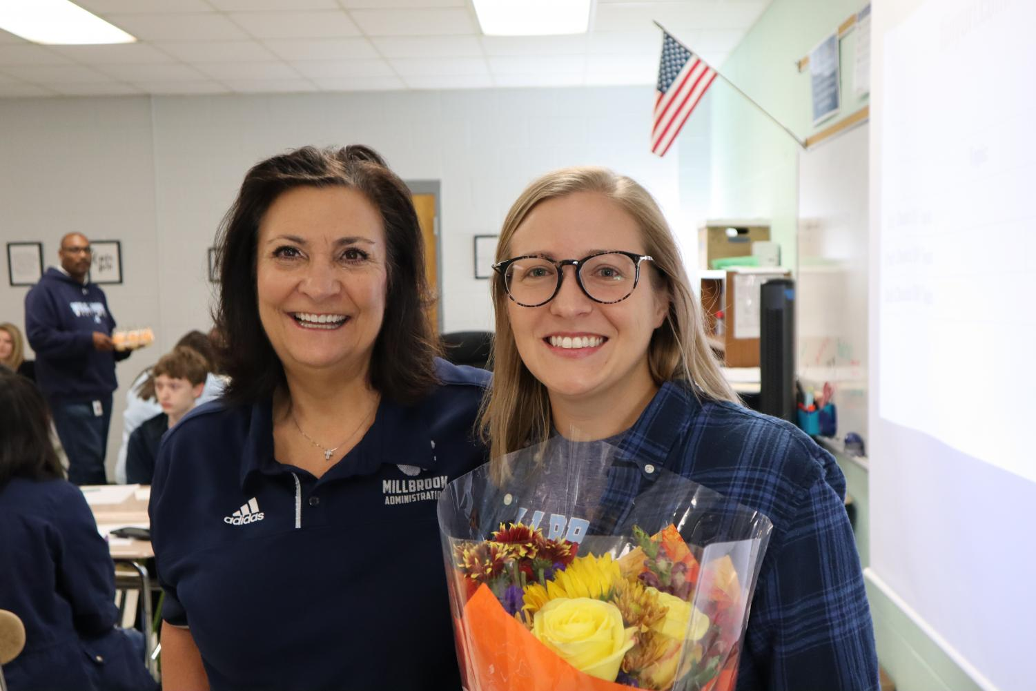 Posing with Principal Dana King, 2019 Teacher of the Year Ms. Fritz is evidently beaming with pride! She has invested much of her time and energy into Millbrook and has now been recognized for her involvement, much to the amusement of students Will Mitchell, Avery Glenn, and countless others!