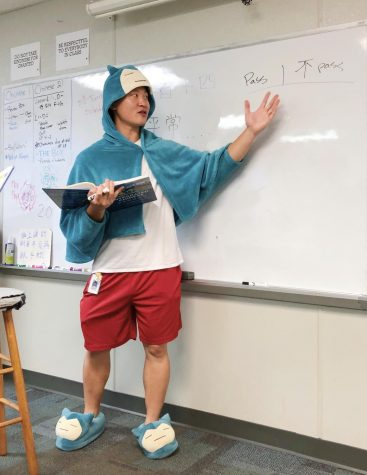 Showing off his school spirit on Morning Monday, Mr. Jung explains a fun activity to help his Chinese 2 class learn their new vocabulary. He considers himself lucky to teach students who are hard-working, studious, and willing to learn, which solidifies his confidence as a teacher.