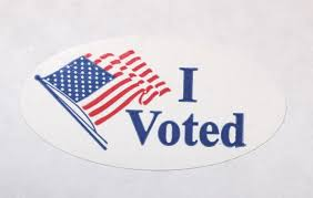 "Depicting the waving American flag, this ""I voted"" sticker can be found on many proud Americans' shirts on Election Day. By making Election Day a Federal Holiday, many more Americans would be able to wear this sticker, without sacrificing anything else."