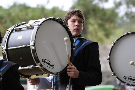 Performing for Millbrook's marching band, junior Ryan Gibson drums to the beat. Ryan serves as a section leader and is a great role model for younger band members.