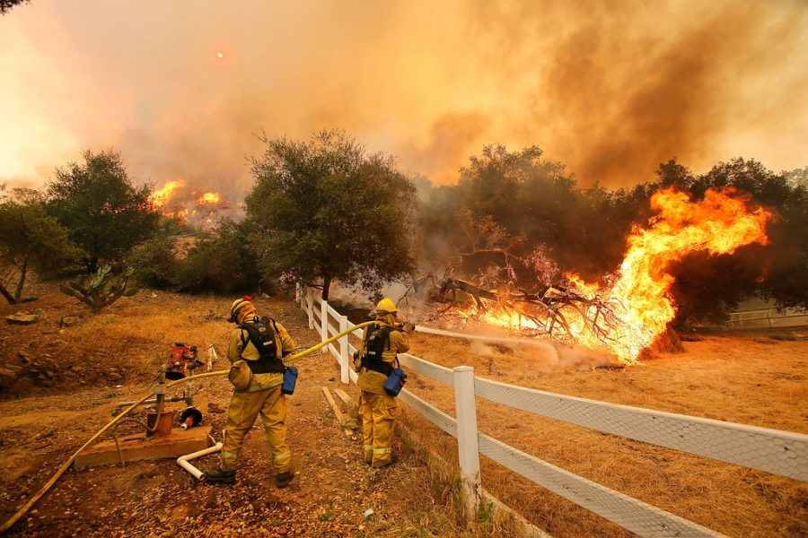 Dowsing+water+into+the+air%2C+these+firefighters+in+Stockton%2C+California+attempt+to+prevent+a+wildfire+from+diverting+towards+people+and+property.+Extreme+weather+such+as+fires+and+hurricanes+have+become+more+frequent+in+recent+years+partly+due+to+changes+in+the+environment.++%0A