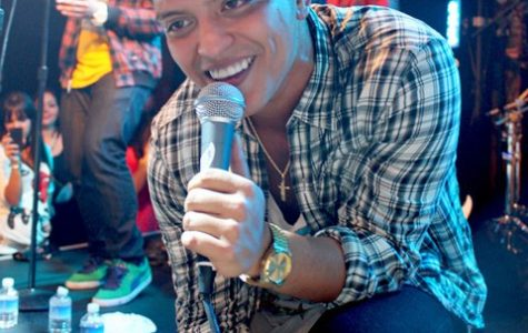 """Serenading a large crowd of fans, singer Bruno Mars performs as a part of his 2014 Moonshine Jungle Tour. Bruno Mars will be remembered as one of the most influential artists of the decade with hits like """"Uptown Funk,"""" """"Just The Way You Are,"""" and """"24K Magic."""""""