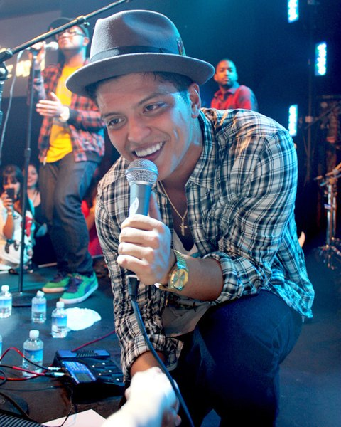 "Serenading a large crowd of fans, singer Bruno Mars performs as a part of his 2014 Moonshine Jungle Tour. Bruno Mars will be remembered as one of the most influential artists of the decade with hits like ""Uptown Funk,"" ""Just The Way You Are,"" and ""24K Magic."""