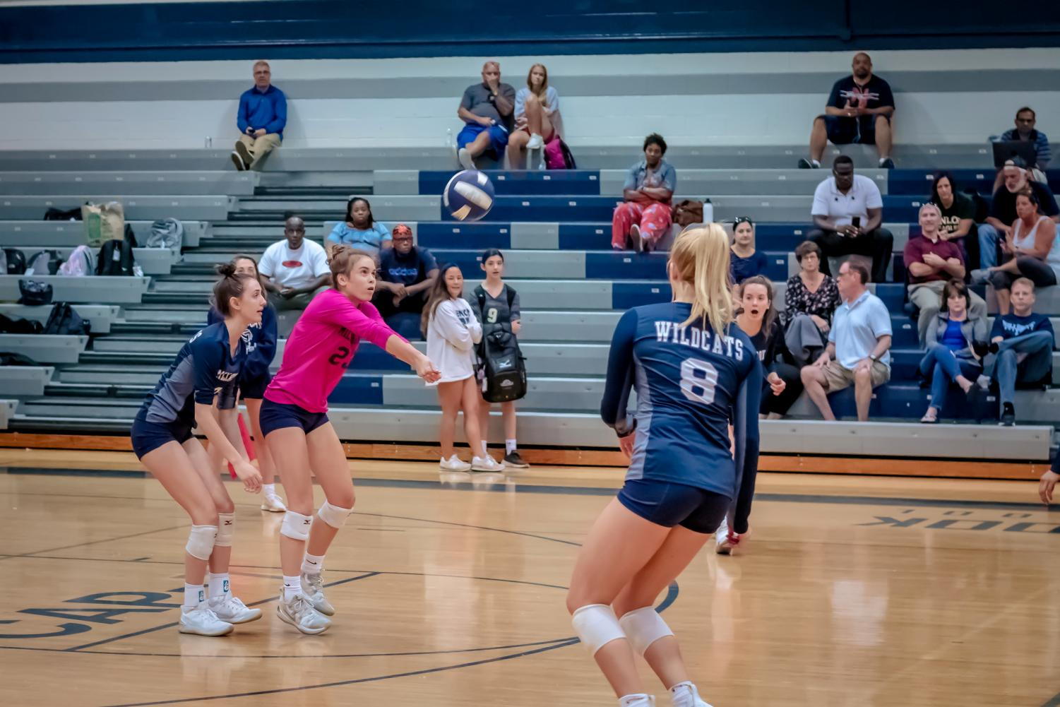Showcasing her athletic determination, freshman Kate Kilpatrick passes the ball to her teammates in hopes of scoring a point. She put in a lot of work to make the Varsity team and is eager to compete at the highest level all while proving herself to her teammates.