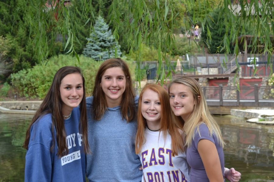 Taking a break from their camp activities, junior girls Ashley Brady, Sydney Hartis, Ashley Burnette, and Annascott Hunt, all show how much joy going to camp can bring. This was during fall camp, which takes place every year at Windy Gap, a YL campsite in Weaverville, NC.