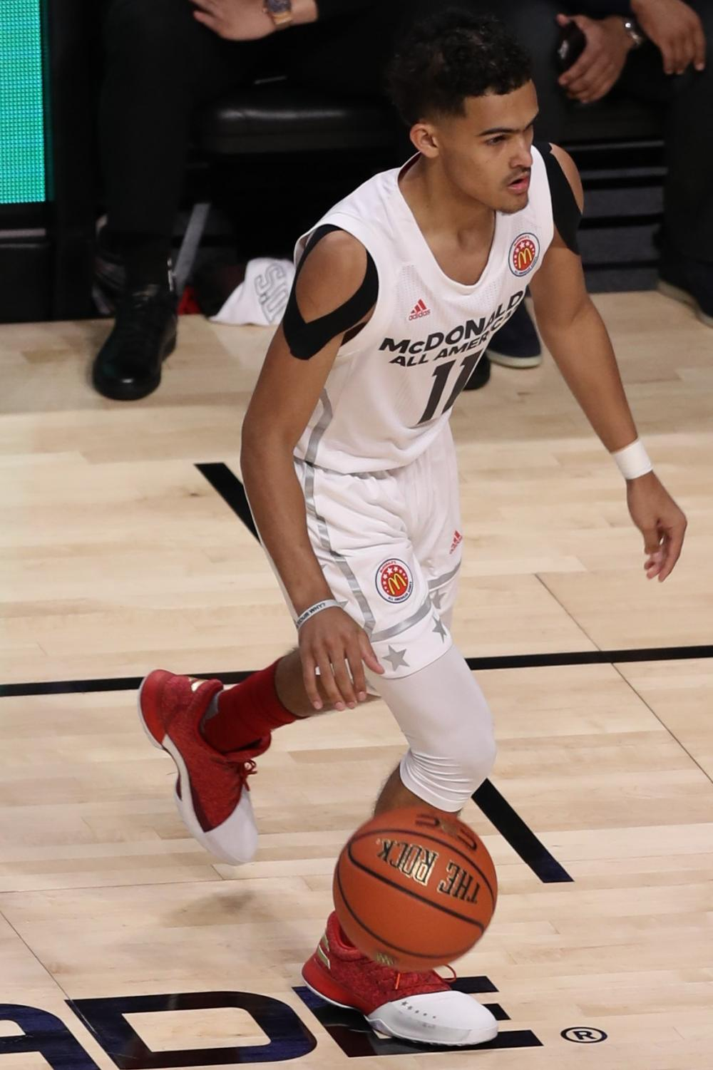 Looking for an open teammate and the best shot available, Trae Young prepares to make a decision as the shot clock draws to an end in the McDonald's All-American Game. Young now lights up scoreboards across the country for the rebuilding Atlanta Hawks and will likely make his first All-Star team in February.