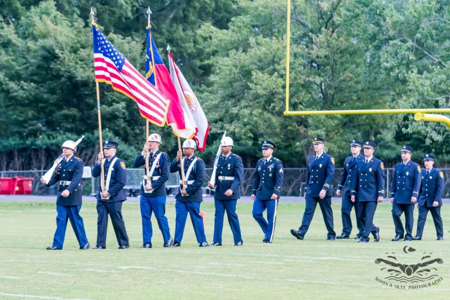 Marching in during the patriotic football game, JROTC's Color Guard carries the nation's colors in, joined by Raleigh's Fire Department. JROTC is a program held at Millbrook that includes students who want to work on their leadership, excellence, and discipline.