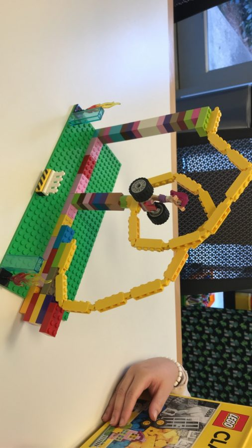 Showing off her charitable creation, junior Vy Chau helps out in her community by volunteering with Learning with Legos. Every year, the organization enlists a number of volunteers to help assist young children in building Lego creations to encourage a love of STEM at an early age.