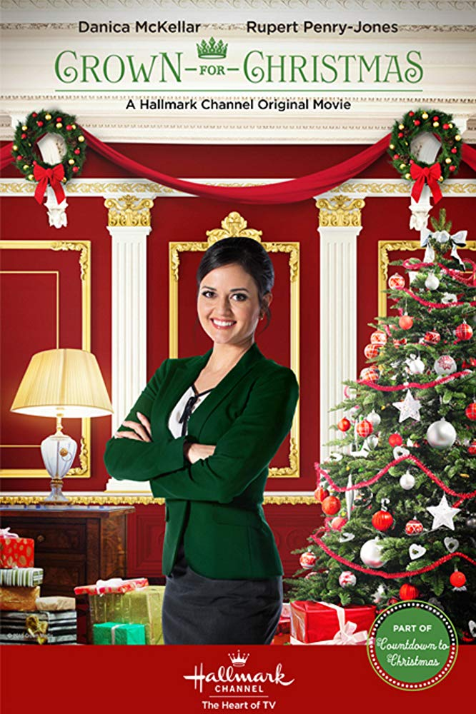 Smiling for the picture, Danica Mckellar poses during A Crown for Christmas. One of the most popular Hallmark movies, it combines romance and comedy to help celebrate the season.