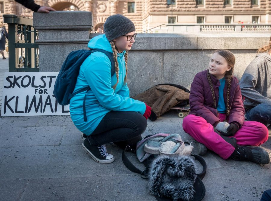 Engaging+with+a+fellow+student+participant%2C+Greta+Thunberg+%28right%29+protests+climate+change+outside+the+Swedish+parliament.+Now%2C+149+countries+and+3.6+million+people+are+involved+in+her+school+strikes.