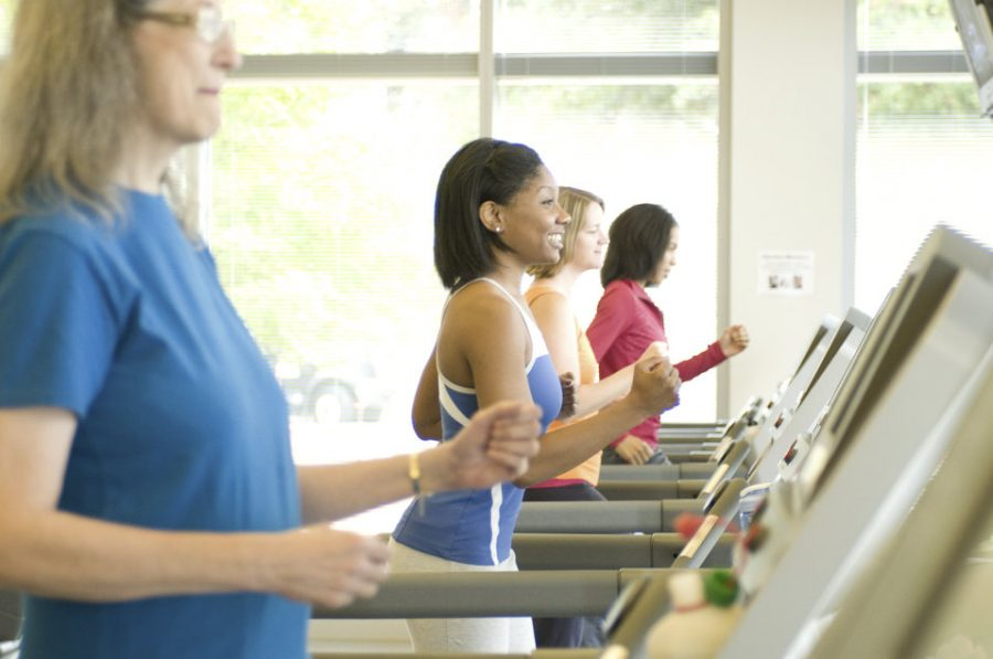 Working out on treadmills, these women hope to burn off calories and improve their ways of life through the gym. Losing weight and keeping a healthy bodily figure is a popular New Year's resolution made by most adults.