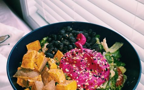 Layered on a bed of fresh salad greens are beetroot hummus, black beans, and roasted sweet potato with warm flavors that make the perfect salad for this season. Incorporating raw and cooked vegetables to salads can make them more interesting and filling to eat.