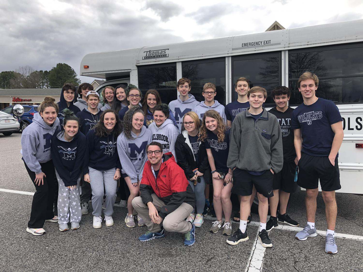 Overjoyed by their successes and a fun bus ride, the Millbrook Aquacats States qualifiers pause to pose for the camera after enjoying a delicious meal together! This picture was taken in between the prelims and finals sessions of their final swim meet of the year.