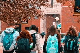 Walking to class, these college students enjoy fellowship and their ability to learn together. As the COVID-19 outbreak has cancelled testing, the UNC system has made admission modifications for those who were unable to redeem themselves during the rest of their high school semester.