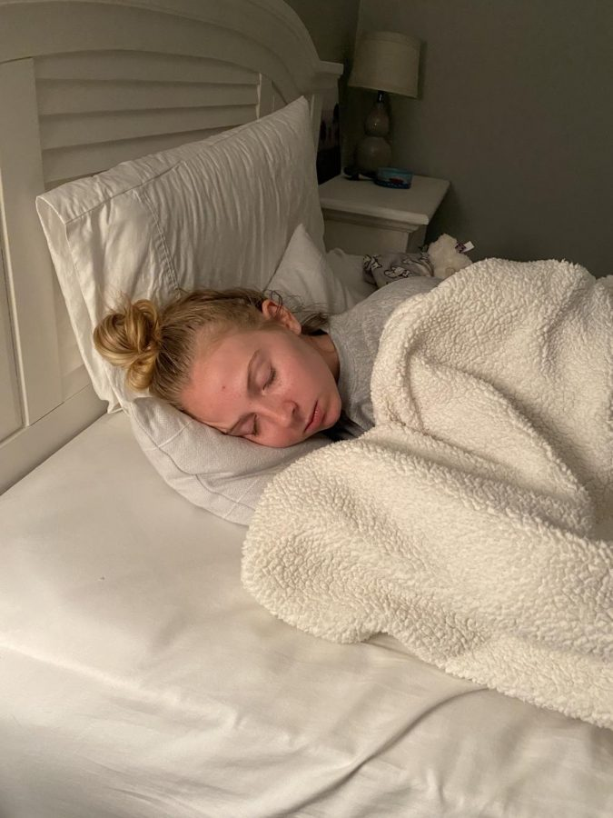 Catching up on her sleep, senior Allie Bettenhausen demonstrates how she uses her free time due to our two-month break. Read to see what you can be doing to make the most of your time!