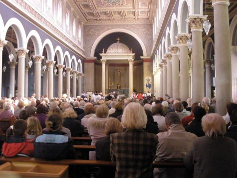 Remembering Jesus' death, church-goers fill the St. Pius X Church on Good Friday. This holiday is for members of the church to acknowledge Jesus' death and its meaning.