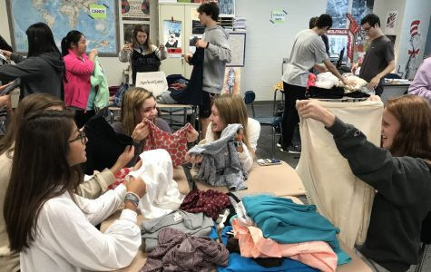 Sorting through collected clothing, members of Key Club volunteer their time to help support Note in the Pocket's mission to clothe children with dignity and love. Note loves to highlight movements like these when kids are helping kids!