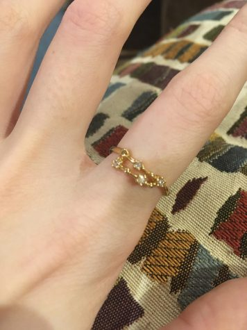 Showing off her new Capricorn inspired ring, junior Casey Parzygnat is proud of her zodiac sign and what it says about her. She believes that since she is a Capricorn, she has a stronger work ethic and a closer bond with her family members.
