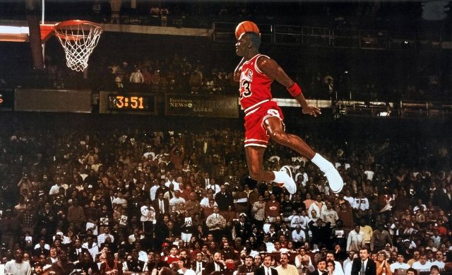 Taking flight in the 1987 Slam Dunk Contest, Michael Jordan jumped from behind the free throw line before receiving a perfect score for this iconic dunk. Jordan is featured in a recently complete documentary about the Bulls dynasty and their final season together.