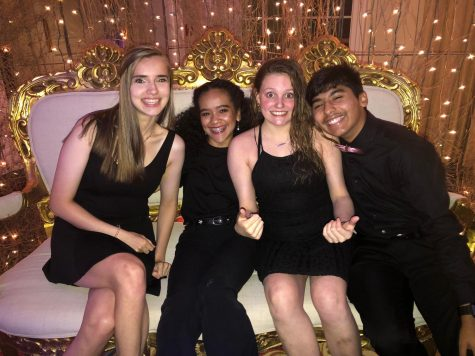 Getting in close for a picture, Xavier Amaro (far right)  smiles with his friends while helping out at prom. Helping out at prom is another feature of being a part of class council, which is one of the many clubs Xavier is involved in.