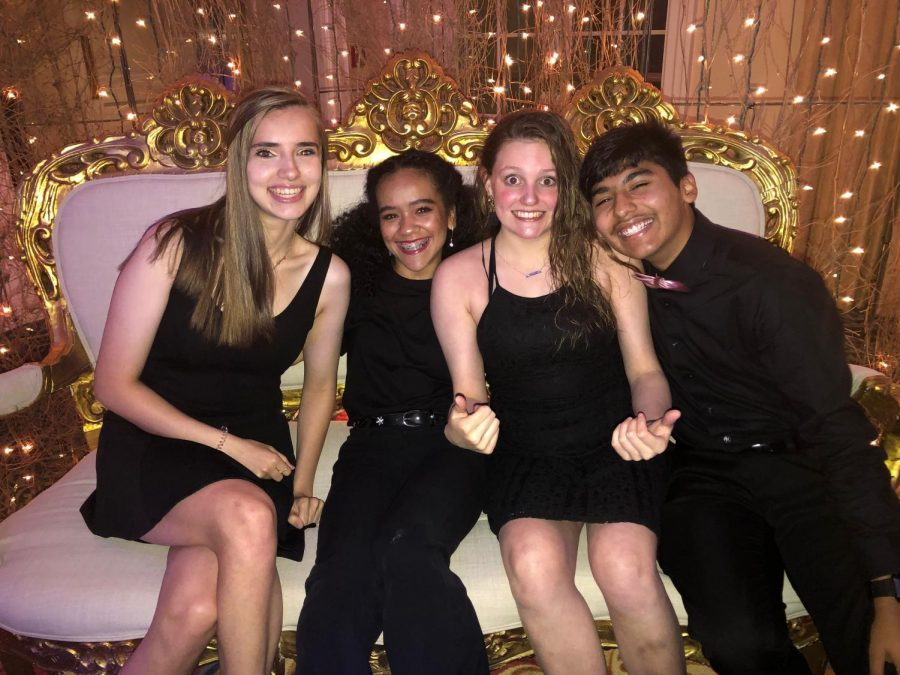 Getting+in+close+for+a+picture%2C+Xavier+Amaro+%28far+right%29++smiles+with+his+friends+while+helping+out+at+prom.+Helping+out+at+prom+is+another+feature+of+being+a+part+of+class+council%2C+which+is+one+of+the+many+clubs+Xavier+is+involved+in.%0A