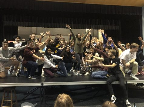 Posing after rehearsing one of their musical numbers, the talented cast and crew of this year's spring musical Anything Goes have fun during one of their last run-throughs. The show's cancellation was heartbreaking to the cast, crew, and Millbrook community.