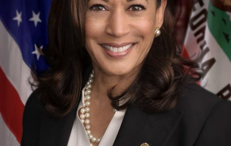 Posing for a photo taken upon assuming her California senator position, Kamala Harris is pictured as she began her journey in the field of politics. Since then, she has assumed multiple national level positions, including her current run for Vice President of the United States.